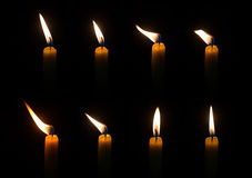 Candle. Four light candle burning brightly in the black background Royalty Free Stock Photos