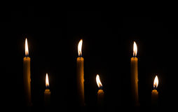 Candle. Four light candle burning brightly in the black background Stock Photography