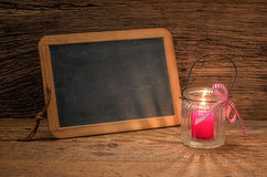 Candle in front of a  chalkboard Royalty Free Stock Photos