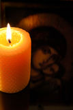 Candle in front of virgin Mary Royalty Free Stock Photo
