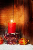 Candle in front of wood Royalty Free Stock Photos
