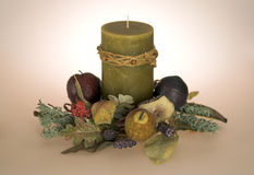 Candle with Fruit Base. Beautiful olive candle with fruit base Royalty Free Stock Photos