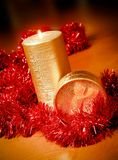 Candle and gift box with red tinsel Stock Photography