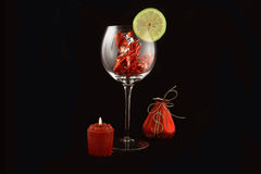 Candle and glass. Arrangement to a celebratory table for New year Royalty Free Stock Image