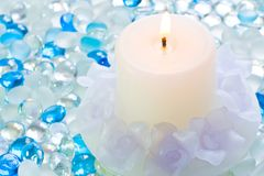 Candle on glass balls Stock Photography