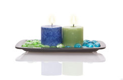 Candle and glass balls in plate Royalty Free Stock Images
