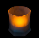 Candle in a glass beaker. Stock Photos