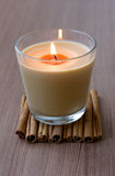 Candle in the Glass and Cinnamon Stock Photo
