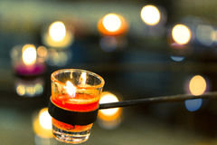 Candle in a glass. Focused Red candle in a glass with round stick stand Royalty Free Stock Photo