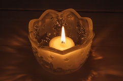 Candle in glass jar Stock Photo