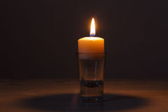 Candle in glass jar Stock Image