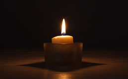 Candle in glass jar Stock Photos
