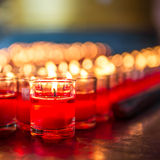 Candle in glass. Red candle is kindle a fire in glass Stock Photos