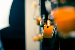 Candle in glass shelves. Fire Royalty Free Stock Photography