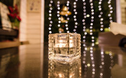 Candle in glass under yellow lighting Stock Image