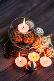 A candle in a glass vase, decoration and various interesting elements. Candles burning. Royalty Free Stock Photos