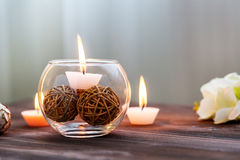A candle in a glass vase, decoration and various interesting elements. Candles burning. Royalty Free Stock Photo