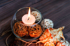 A candle in a glass vase, decoration and various interesting elements. Candles burning. A candle in a glass vase, decoration and various interesting elements on Royalty Free Stock Photos