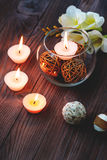 A candle in a glass vase, decoration and various interesting elements. Candles burning. A candle in a glass vase, decoration and various interesting elements on Stock Image
