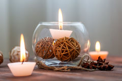 A candle in a glass vase, decoration and various interesting elements. Candles burning. A candle in a glass vase, decoration and various interesting elements on Stock Photo