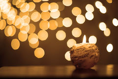 Candle with glitter and rain of sparkles Stock Photos