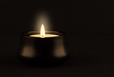 Candle glowing in the dark Royalty Free Stock Photography