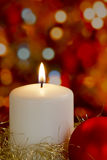 Candle with gold tinsel and bauble Royalty Free Stock Photos
