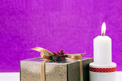 Candle and golden gift box on celebration background Royalty Free Stock Photography