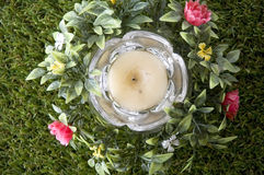 Candle on grass Stock Photography