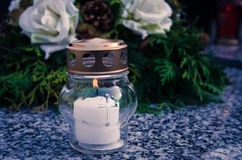 Candle on grave Royalty Free Stock Photography