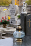 Candle on a gravestone. Royalty Free Stock Image