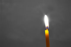 Candle on a gray background Stock Image