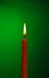 Candle On Green Royalty Free Stock Image