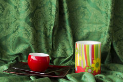 Candle on green fabric Royalty Free Stock Photos