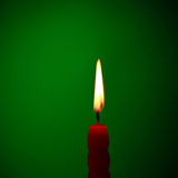 Candle On Green Stock Image