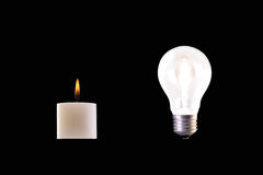 Candle and halogen lamp Royalty Free Stock Image