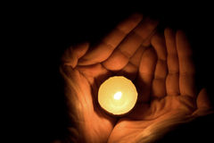 Candle in hand. Image of hand holding a tealight candle in hand Royalty Free Stock Photos