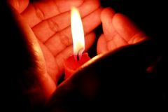 Candle in hand Stock Photos