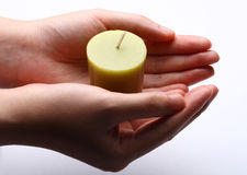 Candle in hand Stock Images