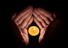 Candle in the hand, Hope concept Royalty Free Stock Image