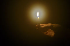 Candle in a hand Stock Photo