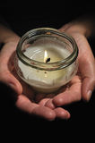 Candle in hands. Candles in hands for All Souls Day Royalty Free Stock Image