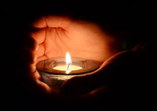 Candle in the hands. Abstract Royalty Free Stock Images