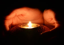 Candle in the hands Stock Photography