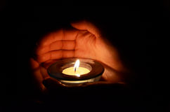 Candle in the hands. Abstract Stock Photography