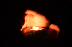 Candle in the hands. In the darkness Stock Photos