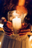 A candle in the hands of a newlywed couple. Wedding in Montenegr. O Stock Image