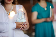 Candle in the hands of the newlyweds. Wedding. Candle in the hands of the newlyweds Royalty Free Stock Photography