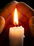 Candle in hands Royalty Free Stock Images