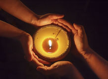 Candle in the hands Royalty Free Stock Photo